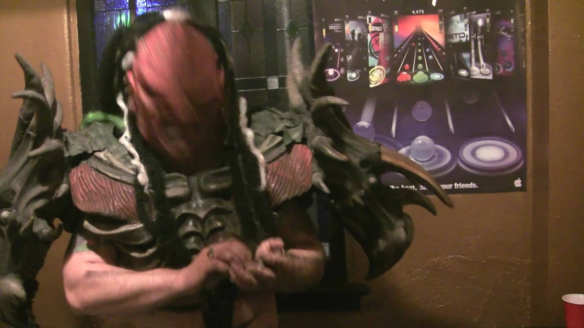 GWAR's Flattus Maximus in a Tap Tap Revenge 3 battle against fans